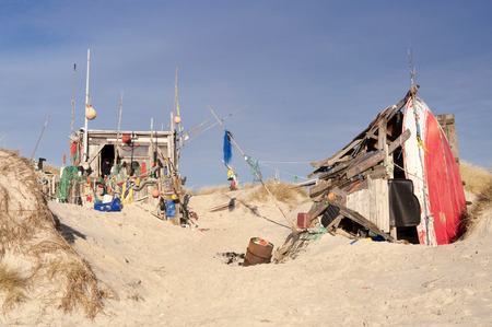 sandbank: AMRUM, GERMANY - DECEMBER 29, 2014: On the Kniepsand Beach of  the North Frisian Island Amrum in Germany Land-Artists made Beach Huts and other Objects out of Flotsam and Jetsam