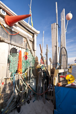 barrack: AMRUM, GERMANY - DECEMBER 29, 2014: On the Kniepsand Beach of  the North Frisian Island Amrum in Germany Land-Artists made Beach Huts and other Objects out of Flotsam and Jetsam