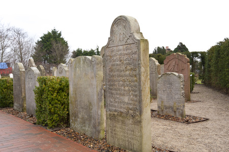 mariner: AMRUM, GERMANY - DECEMBER 31, 2014: In Nebel on the North Frisian Island Amrum in Germany the historic Sailor Tombstones have been restored. They are called speaking Grave Stones