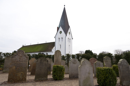 stone of destiny: AMRUM, GERMANY - DECEMBER 31, 2014: In Nebel on the North Frisian Island Amrum in Germany the historic Sailor Tombstones have been restored. They are called speaking Grave Stones