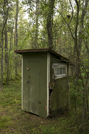 outhouse: Outhouse toilet in a forest in Sweden Stock Photo