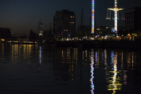 Reflective Night Lights on a Water Surface on the Kiel Week Festival in Germany