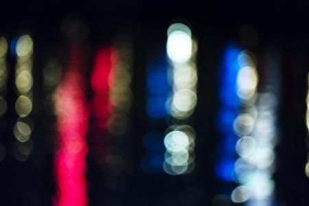 Reflective Night Lights on a Water Surface on the Kiel Week Festival in Germany