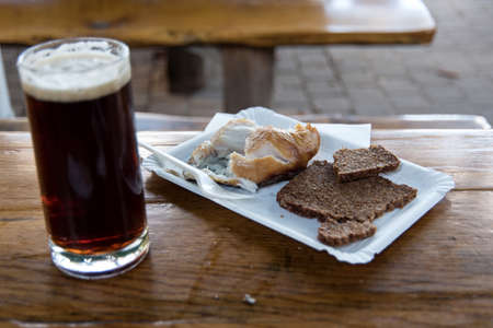 Smoked fish with black beer on Fischland in Germany 免版税图像
