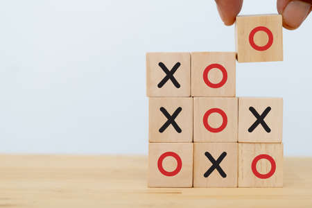 tic tac toe concept. leader business man try flip wooden cube to speed win the game of OX for fast winning by using strategy to make opportunity success . copy space