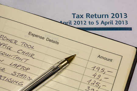 tax return: Tax Return form and expense book Stock Photo
