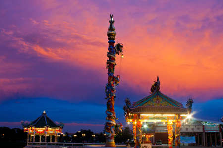 colorful sky of sunset and pavilion chinese style