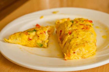 Omelet in a white dish Stock Photo