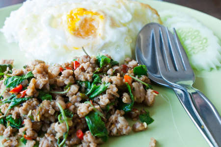 Basil fried rice with fried egg with minced pork
