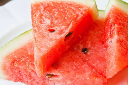 Watermelon on a white dish Stock Photo