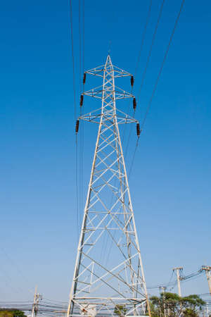 High voltage power pole and the blue sky photo