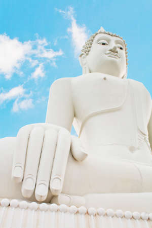 Buddha thailand on blue sky photo