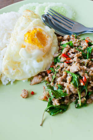 Minced pork fried rice with basil and fried egg photo
