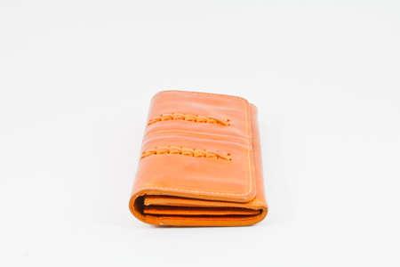 Wallet orange on a white background photo