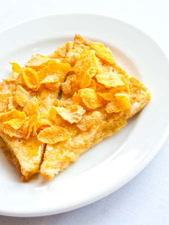 Bread topped with honey and cereal photo