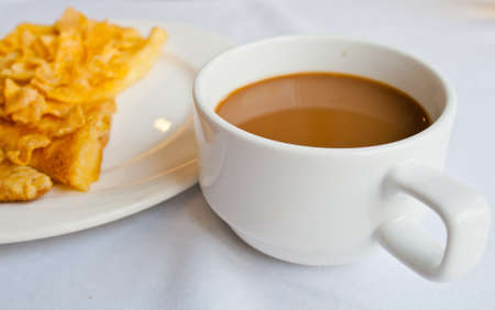 Coffee and bread topped with honey photo