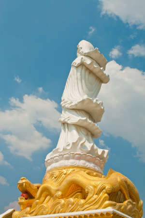 kuan yin on dragon statue and blue sky Stock Photo - 13039486