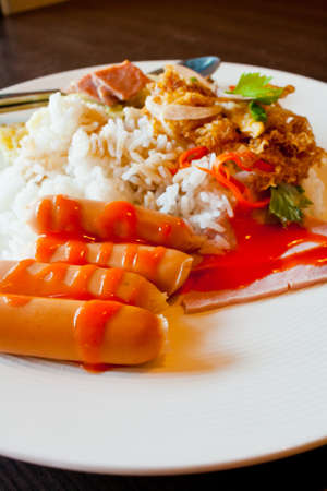Thai food sausage rice and curry photo