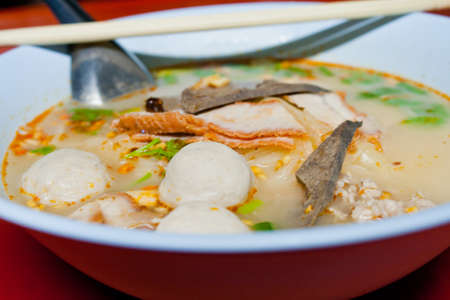 Pork noodle in a bowl thai food photo