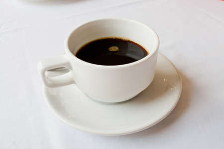 Black coffee in a white cup photo