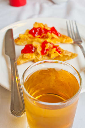 Apple juice and bread on a white dish photo