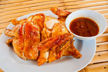 Thai roasting chicken on a white dish photo