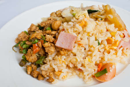Fried rice with pork on a white dish photo