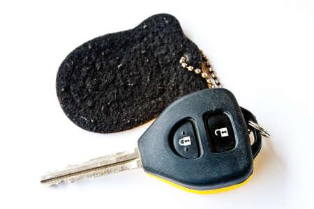 Car keys on a white background