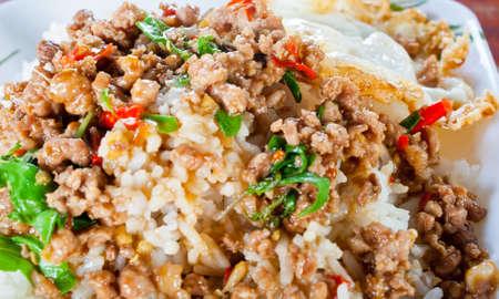 Fried rice pork with sweet basil Stock Photo