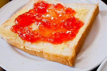 Bread with strawberry jam photo