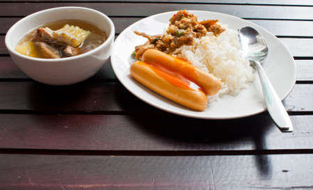 Thai food curry with rice on a white dish photo