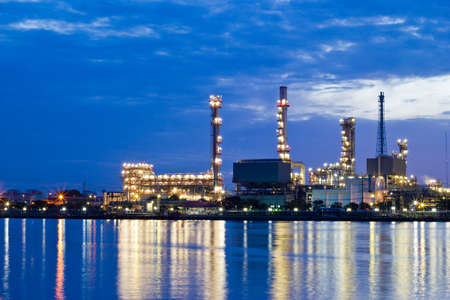 Oil refinery at twilight Bangkok Thailand photo