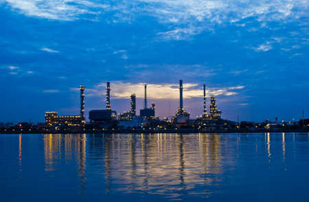 Oil refinery at twilight Bangkok Thailand photo