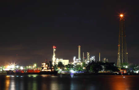 Oil refinery at night Bangkok Thailand photo