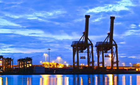 Containers and cranes at the port at sunrise in Bangkok, Thailand