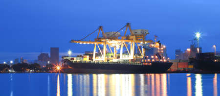 Panorama of Industrial Container Cargo freight ship with working crane for Logistic Import Export photo