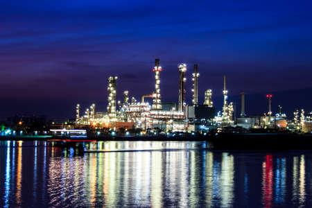 Oil refinery at twilight Chao praya river Bangkok Thailand