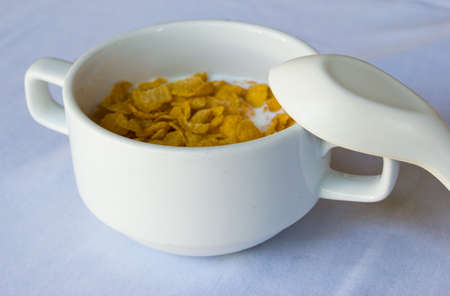 Breakfast cereal and milk in a white cup Stock Photo