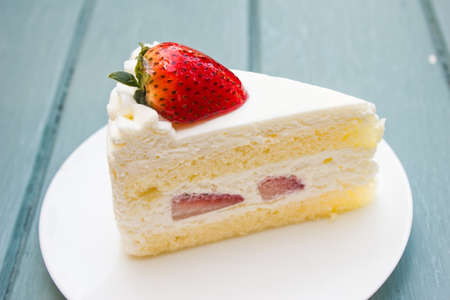 Strawberry cake on white plate photo