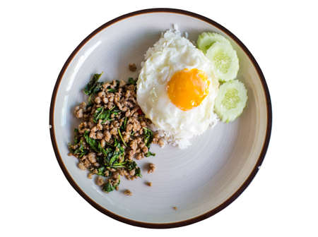 Thai food Basil fried rice with pork and fried egg on white background