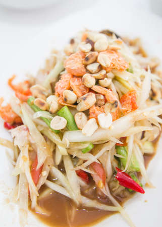 Thai papaya salad hot and spicy mixed vegetable closeup photo