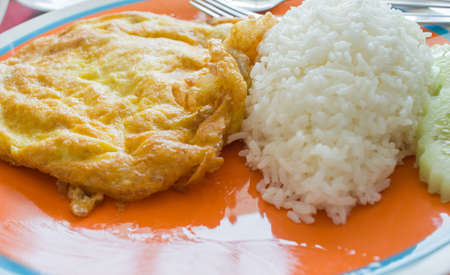 topped: Omelet with rice on the dish Stock Photo
