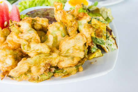 fritters: Vegetable fritters on white dish