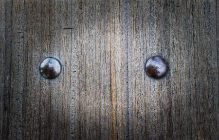 Old wooden surface with steel bolts