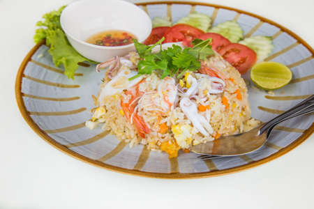 Seafood fried rice in dish on white background