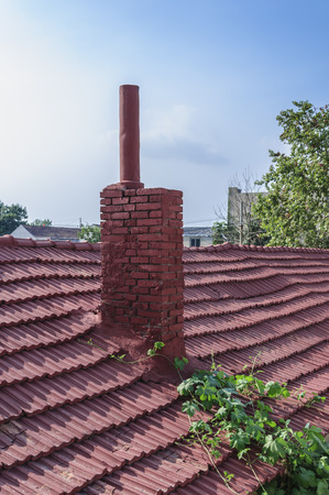 pitched: chimney on the roof Stock Photo