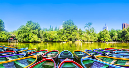 colorful water surface: Wooden boat