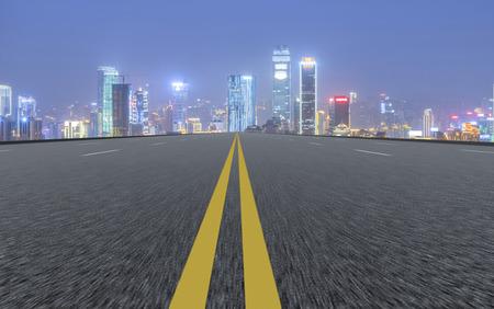 tarmac: Asphalt road and city skyline landscape view