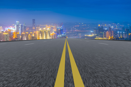 Road and city skyline Stock Photo