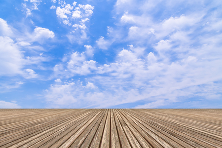 Blue sky with white cloud and a wooden platform